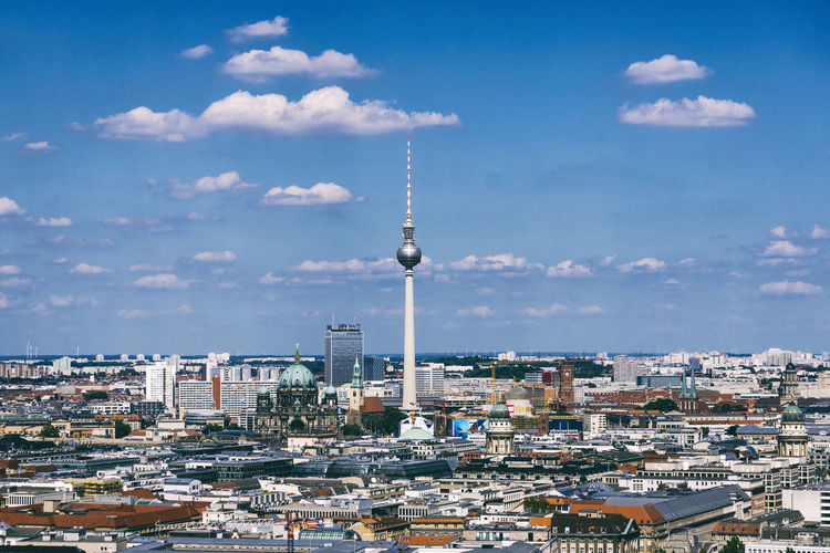 Aerial View Of Fernsehturm In City Against Sky During Sunny Day
