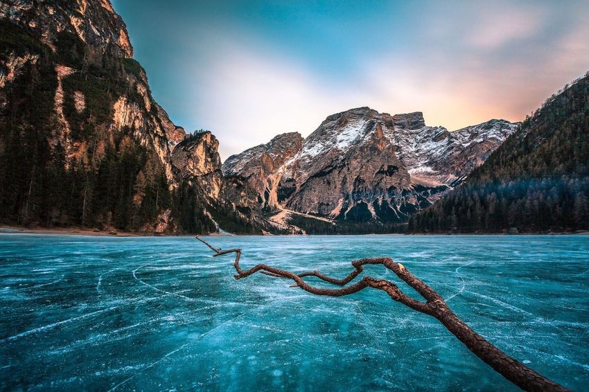 Mountain Sky Beauty In Nature Water Scenics Waterfront Mountain Range No People Tranquility Nature Outdoors Tranquil Scene Snow Sea Day Lago Lagodibraies South Tyrol Frozen Lake Dolomites, Italy Mountains