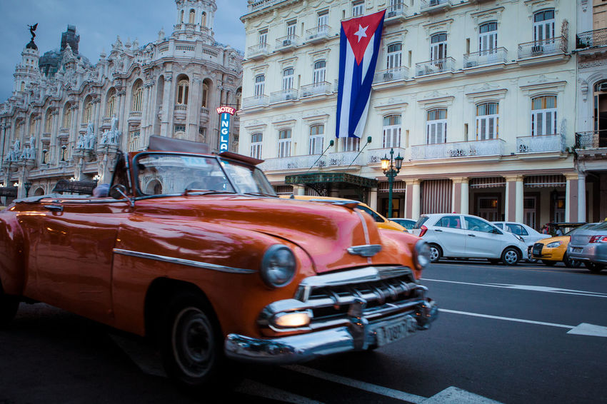 Vintage classic american car in a old street of old Avana, Cuba. Car City Cuba Cuba Collection Cuban Cuban Cars Flag Land Vehicle Old Old American Car Old American Cars Old Building  Old Buildings Old Car Old Town Orange Car Outdoors Transportation Transportation Travel Destinations Vintage Cars