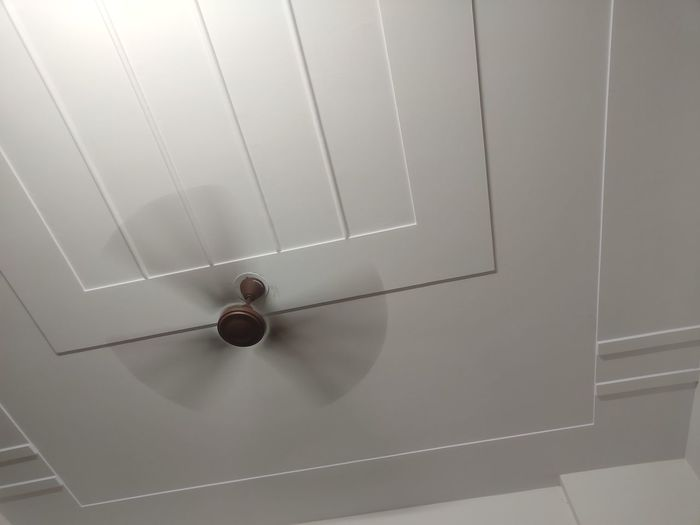 Low angle view of electric lamp on wall at home