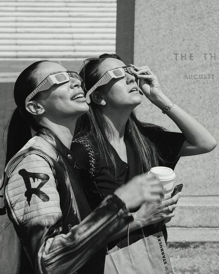 Get eclipsed... Two People Togetherness Mid Adult Eclipse Eclipse Glasses DetroitMichigan The Week On EyeEm EyeEm EyeEmNewHere EyeEm Selects Detroit, MI Eclipse 2017 Eclipse Portrait Eclipse Of The Sun Black And White Photography Black And White Portrait Young Women Women Bonding Close-up People Day Glasses Glasses Series City