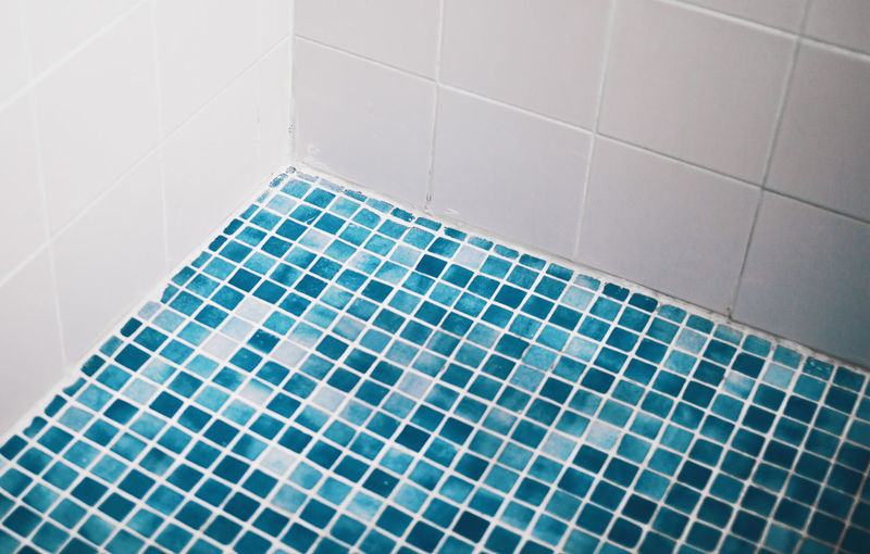 High angle view of tiled floor in bathroom