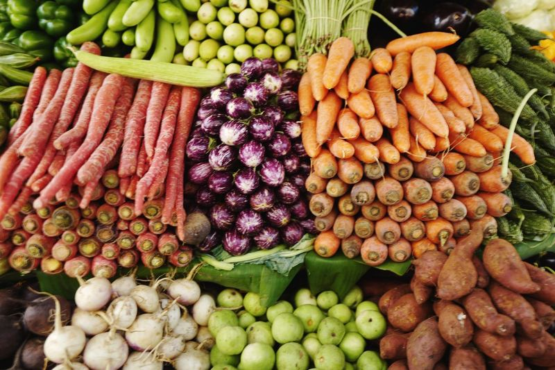 Close-up of fresh vegetables at market stall for sale