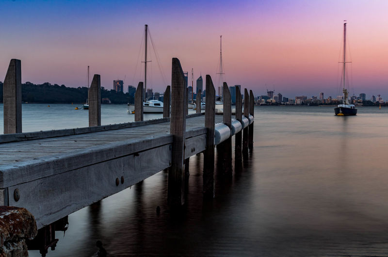 Dusk at Matilda Bay Architecture Marina Nature Pier Post Transportation Beauty In Nature Built Structure Mode Of Transportation Moored Nautical Vessel No People Outdoors Sailboat Scenics Scenics - Nature Sea Sky Sunset Vacation Water Wood - Material