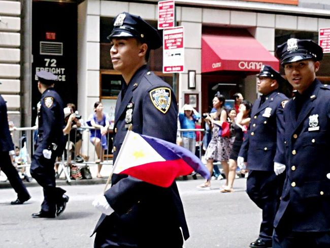 The Street Photographer - 2016 EyeEm Awards Izzymaxie I was in New York and I was able to watch a street parade to commemorate Philippines Independence Day along Manhattan Avenue. Among them some Filipino policemen and they allow me to take their photos Street Photography NYPD Streetparade