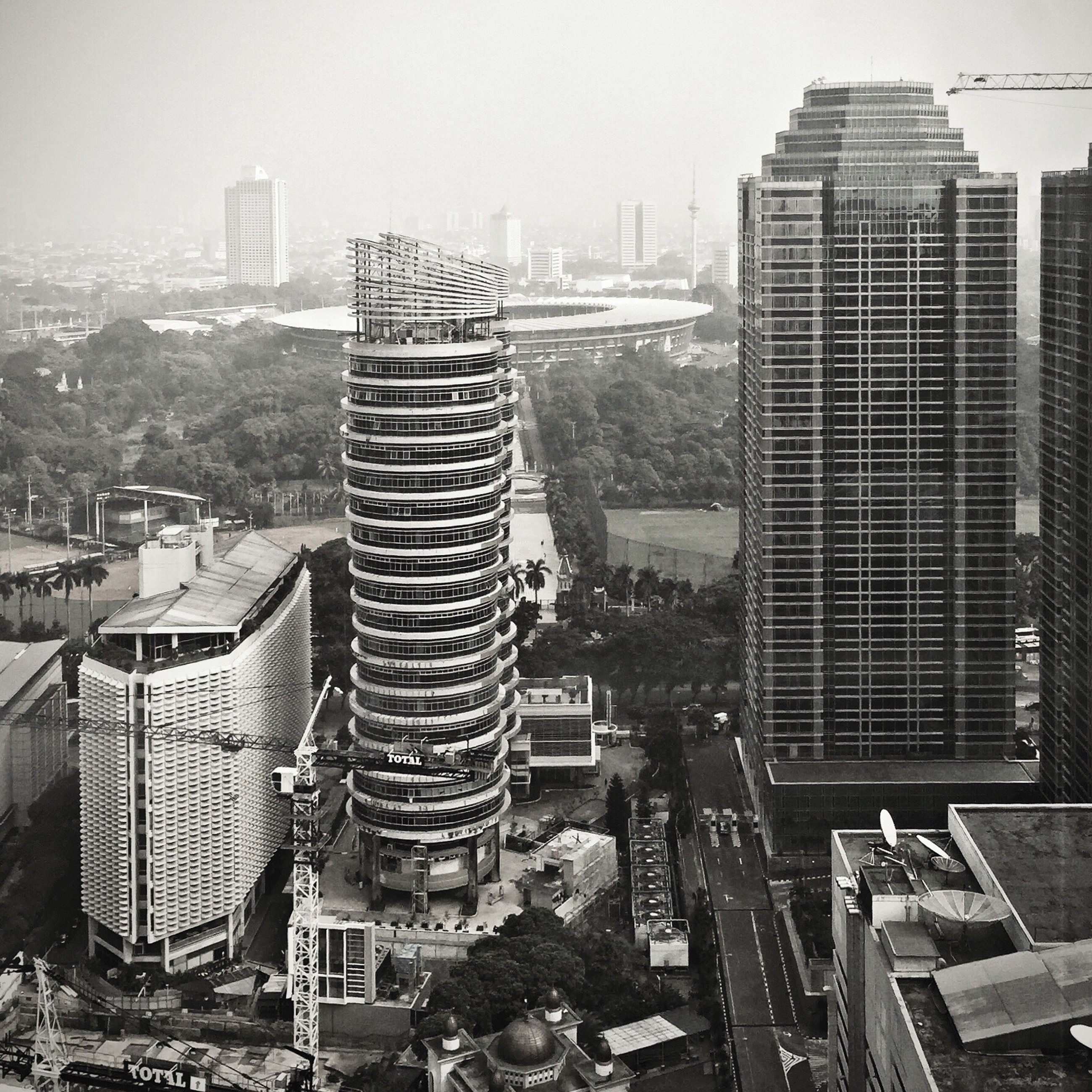building exterior, city, architecture, built structure, cityscape, skyscraper, tall - high, modern, office building, crowded, tower, residential building, high angle view, urban skyline, residential district, building, city life, development, sky, outdoors