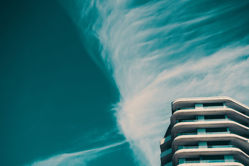 WAVES Nature Architecture No People Built Structure Day Outdoors Sky Cloud - Sky Building Exterior Water Motion Sea Building Beauty In Nature Low Angle View Scenics - Nature Tower Blue Aquatic Sport Skyscraper