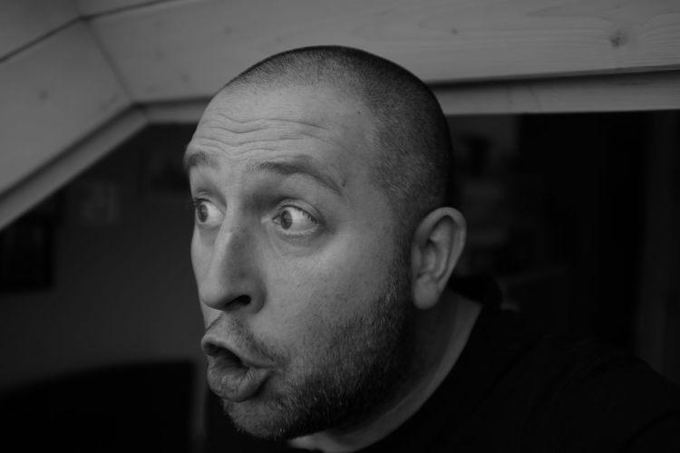 Close-up of shocked man