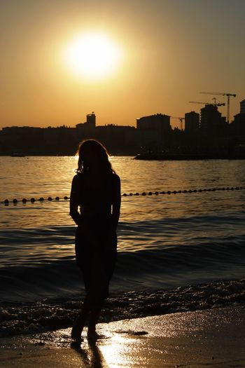 chasing sunsets Sunset Water Sun Silhouette Beach Full Length Sea Sunlight Sky Architecture Real People Built Structure Building Exterior Outdoors Sand One Person Nature Lifestyles Women Scenics