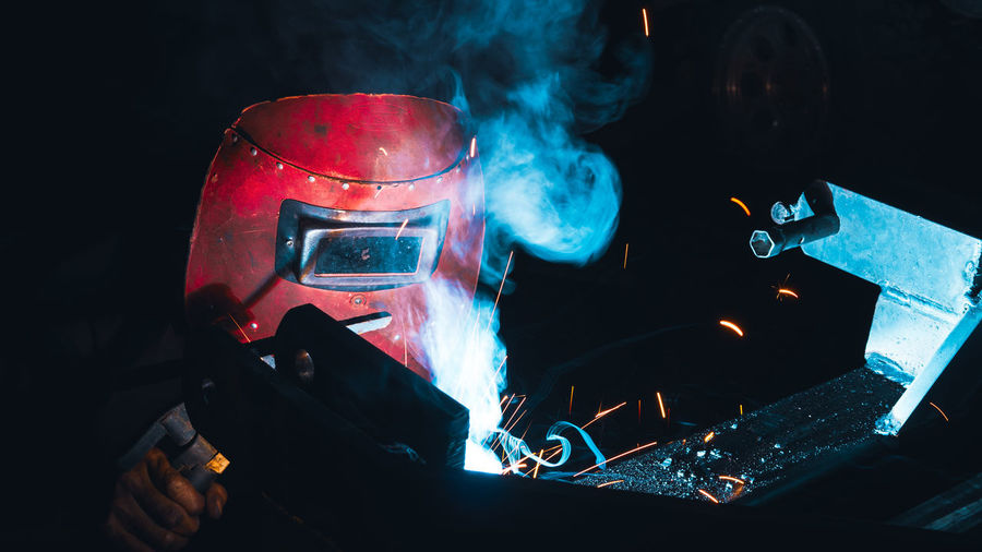 Close-up of hand holding illuminated car