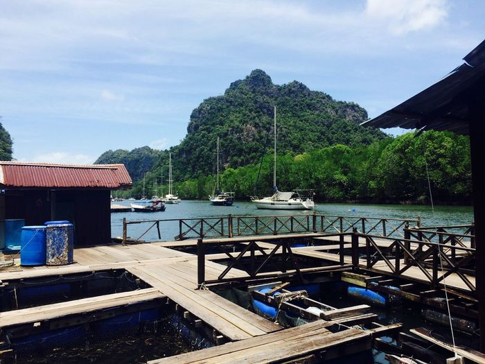 Fish farms with view Beauty In Nature Scenics Architecture Moored Mountain No People Outdoors Day Sea Nature Tree Nautical Vessel Sky Water Southeastasia Southeast Asia EyeEmNewHere