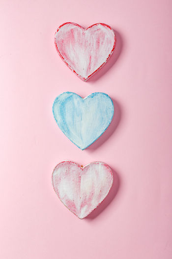 Directly above shot of heart shape over pink background