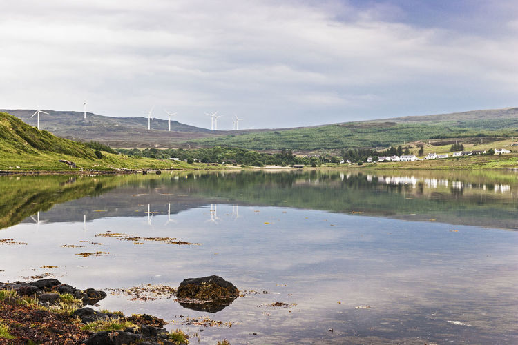 Reflections in Loch Greshornish on the Isle of Skye, Scotland, UK. Beauty In Nature Cloudy Day Highlands Isle Of Skye Landscape Loch Greshornish Non-urban Scene Outdoors Reflection Scenics Scotland Tourism Tranquil Scene Travel Destinations Windfarm
