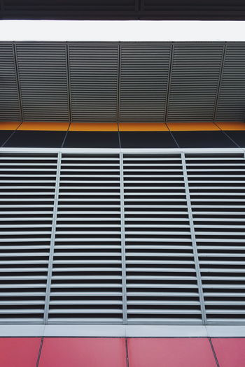 High Angle View Of Metal Grate By Wall
