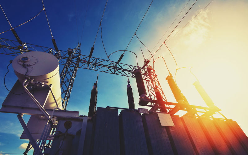 Main Power Plant Energy ideas And energy saving Sky Low Angle View Nature Built Structure Sunlight Architecture No People Day Metal Building Exterior Sunbeam Outdoors Cable Sun Fuel And Power Generation Building Sunset Technology Connection Lens Flare Power Supply