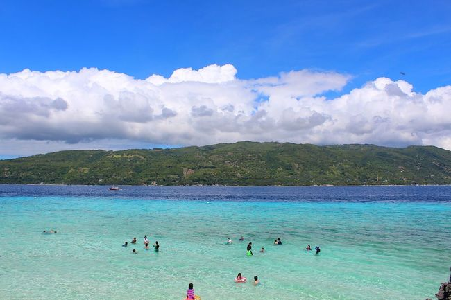 Vacations Beach Large Group Of People Water Summer Cloud - Sky Swimming Blue Sand Sky Sunny Tourism Relaxation Beauty Tourist Resort Tropical Climate Outdoors Travel Destinations Landscape