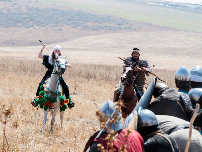 Tiberias, Israel, July 01, 2017 : Participants in the reconstruction of Horns of Hattin battle in 1187 moving around the battlefield near Tiberias, Israel Battle Cross Crusaders Field Fire Guy De Lusignan Hattin Heat Heritage History Horn Horseman Infantry Israel Jerusalem KINGDOM Knight  Muslims Palestine Religion Saladin Templars Victory War Weapons