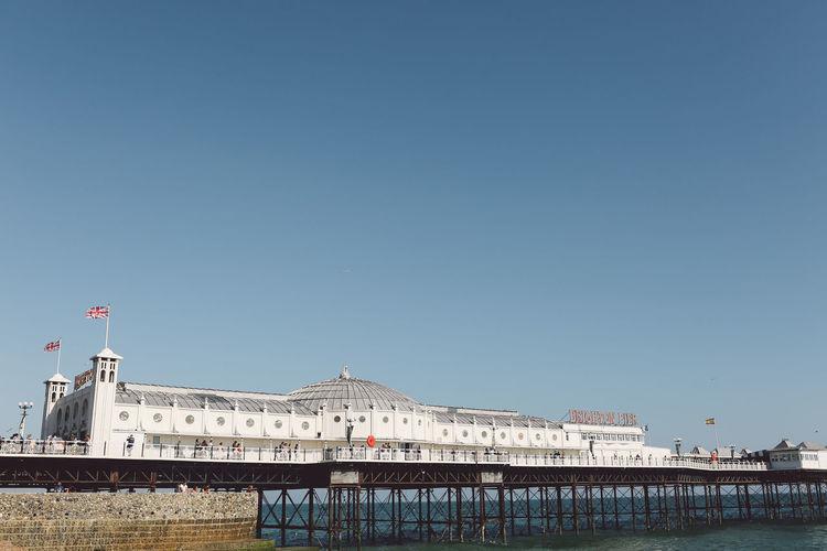 Palace Pier Over Sea Against Clear Sky