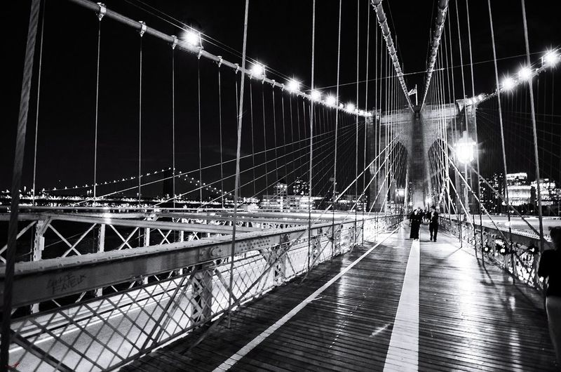 Brooklyn bridge #photography #EyeEmNewHere #blackandwhite #streetphotography #EyeEm #Brooklynbridge #new York #brooklyn City Full Length Suspension Bridge Bridge - Man Made Structure Illuminated Men Sky Architecture Arch Bridge Office Building