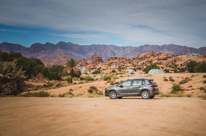 Car on mountain against sky