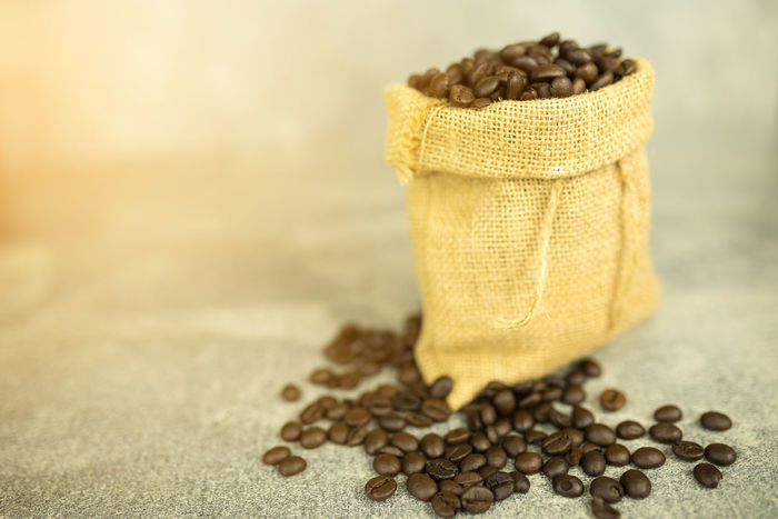 coffee bean and sackcloth Coffee Bean Close-up Coffee Bean Day Food Food And Drink Freshness Healthy Eating Indoors  No People Raw Coffee Bean Sack Sackcloth Still Life Table