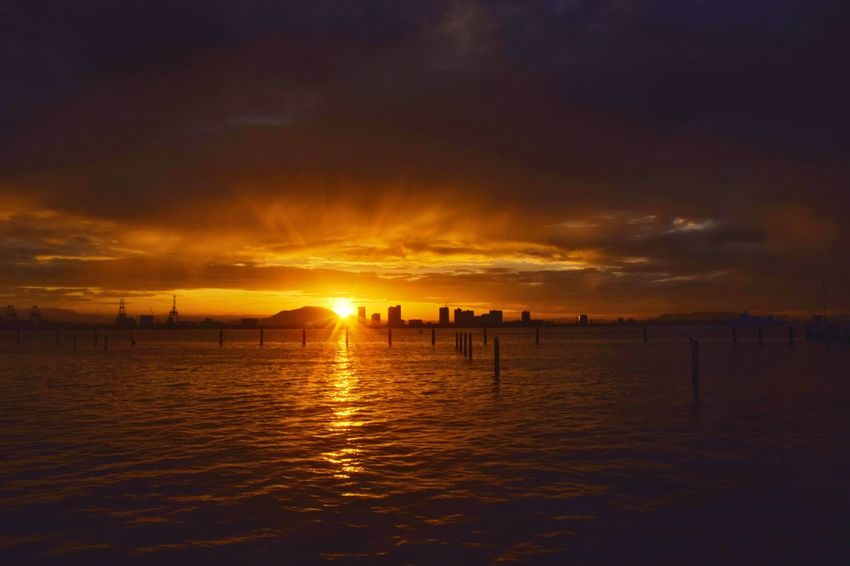Sunrise over Weld Quay waterfront, George Town, Penang, Malaysia. Sunrise Morning Sunlight New Day Water Sea Beach Silhouette Sky Horizon Over Water Tide Dramatic Sky Coast Ocean Wave Seascape