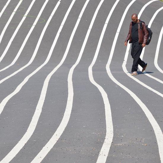 Full length of a man walking on road