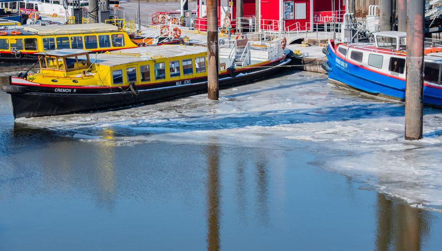 Boats moored on sea