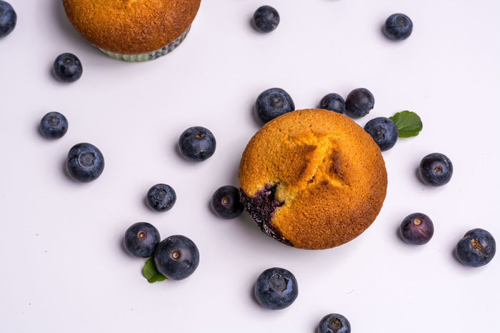 Blueberry muffins on white background from above Above Blueberry Close-up Cupcake Day Food Food And Drink Freshness Indoors  Muffin No People Ready-to-eat Studio Shot Sweet Sweet Food Swett White Background