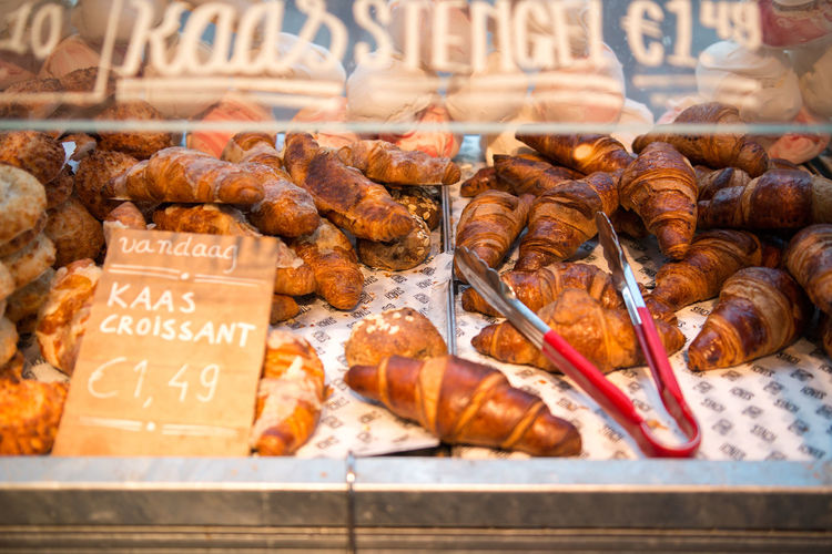 Close-up of croissants for sale in bakery shop