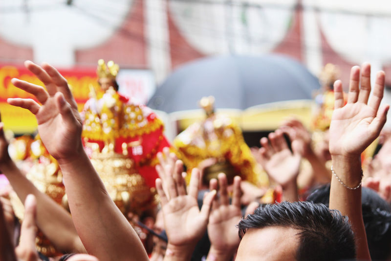 The uwavering faith for Sto. Niño. Devotees are waving their hands as they sing a song of love for. Sto. Niño. Sinulog Festival The Week on EyeEm The Week Of Eyeem EyeEmNewHere Traditional Festival Philippines Large Group Of People Crowd Arts Culture And Entertainment Celebration Performance Cultures Human Hand People Audience Human Body Part Adult Religion Spectator Dancing Music Event Traditional Festival Adults Only Traditional Dancing Visual Creativity