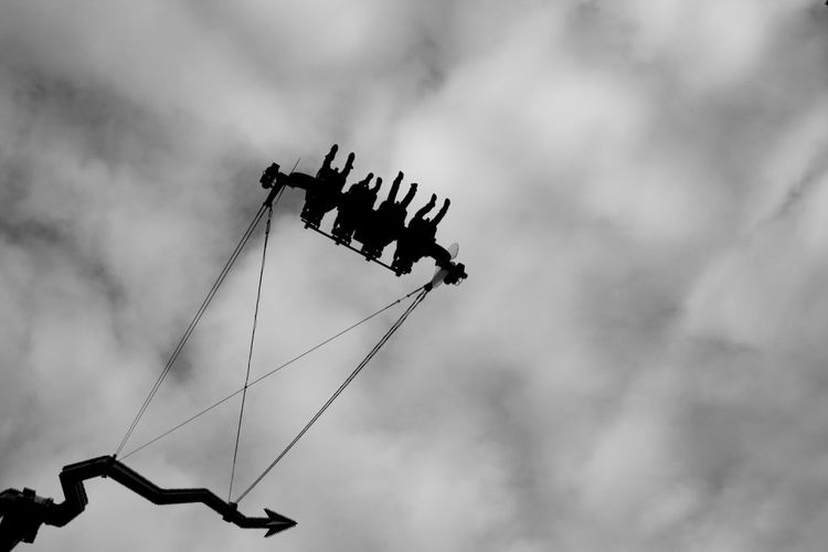 Low Angle View Of People Enjoying On Ride At Prater Park Against Sky