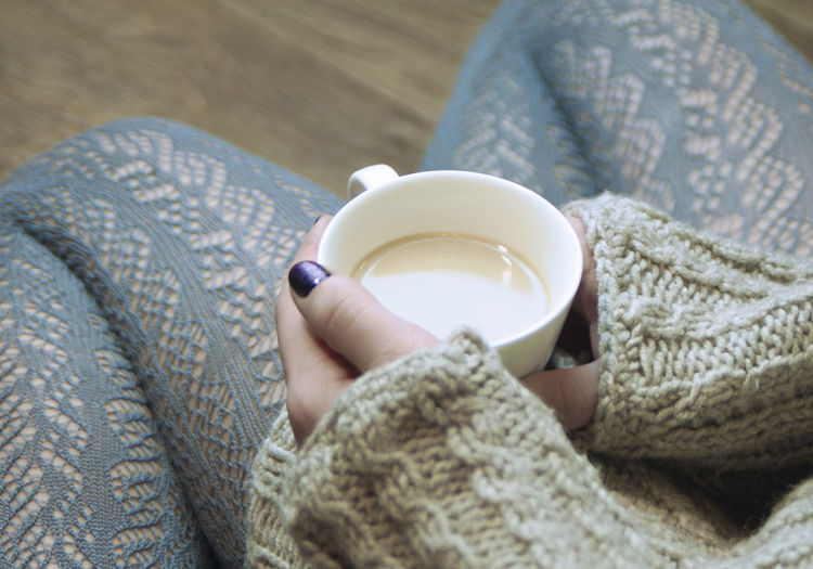 girl in a knitted gray sweater holding a Cup of hot drink Lace Ajurno Cosiness Cozy Keep Warm Team No Talking Relaxing Bright Fall Colors Warm Clothing Warmth