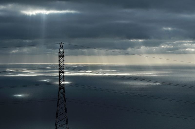 Electricity Tower Electric Wires Electricity  Water Sky Sea Beach Cloud - Sky Land Beauty In Nature Scenics - Nature Horizon Over Water Horizon Nature Non-urban Scene