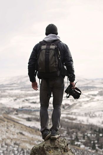 Ready for an epic adventure. Colorado Gold Mountains Snow Hiking Adventure Rear View One Person Backpack Leisure Activity Men Sky Full Length Lifestyles Nature Activity Beauty In Nature Focus On Foreground Rock Rock - Object Standing Day Outdoors Looking At View Camera