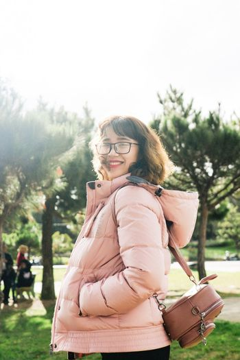 In the sunlight Eyeglasses  One Person Day Standing Smiling Outdoors Looking At Camera Portrait Young Women Young Adult Happiness Adult Real People Tree Women Nature People Adults Only Sky
