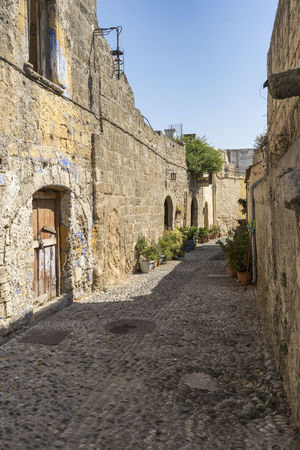 Traditional street of old town, Rhodes, Greece Architecture Old Town Streets Rhodes Greece Ancient Buildings Arch Cobbled Street Day No People Old Town, Rhodes Outdoors