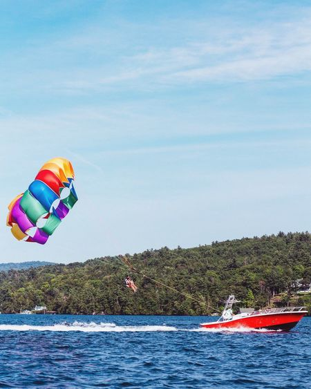 The Color Of Sport Water Sky Transportation Tree Sea Tourism Leisure Activity Waterfront Multi Colored Tranquil Scene Flying Adventure Tourist Tranquility Day Large Group Of Objects Outdoors Mid-air Vacations Parasailing Parasail Lake