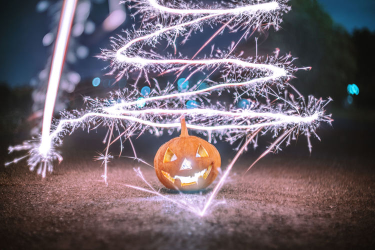 Happy Autumn Time. Halloween 🎃🎃🎃Sparklers around a halloween pumpkins on the streets. Night Light Holiday Autumn Celebration Autumn Leaves Halloween Christmas Glowing Outdoors Christmas Lights Illuminated Decoration Christmas Decoration Event Close-up No People Selective Focus Orange Color Holiday - Event Celebration Event Christmas Ornament