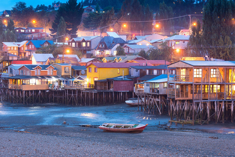 Traditional stilt houses know as palafitos in the city of Castro at Chiloe Island in Southern Chile Architecture Chilean  Chiloé, Chile Cityscape Isla De Chiloe Latin America Palafitos Skyline TOWNSCAPE Boat Castro Chiloe Chile Chiloe Island Chilöe City Colorful Illuminated Latin American Moored Nautical Vessel Night Shore Stilts Houses Traditional
