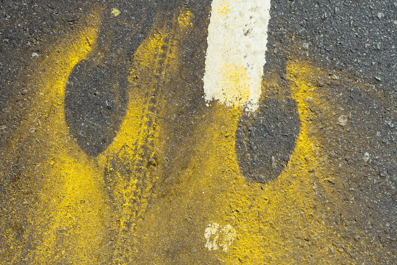 runner's footprint on asphalt marked by yellow powder FootPrint Footprints Paint The Town Yellow Asphalt Day No People Outdoors Road Road Marking Street Textured  Yellow Yellow Color