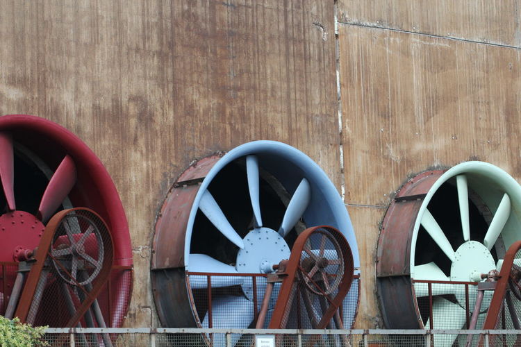 Large fans on wall of factory