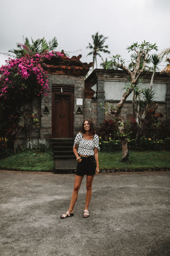Girl smiling in Ubud Full Length One Person Building Exterior Casual Clothing Real People Front View Built Structure Young Adult Young Women Standing Portrait Looking At Camera Outdoors Travel Lifestyle Woman Girl Fashion Happy Smile Bali Bali, Indonesia Flowers Ubud Resort