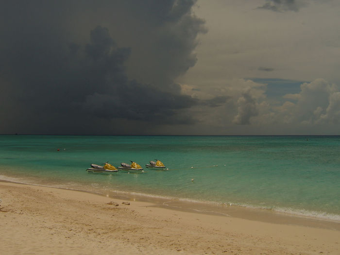 Beach Beauty In Nature Caymanislands Cloud - Sky Darkclouds Day Grandcayman Horizon Horizon Over Water Idyllic Land Nature Nautical Vessel Outdoors Sand Scenics - Nature Sea Sky Storm Cloud Tranquil Scene Tranquility Transportation Turquoise Colored Water