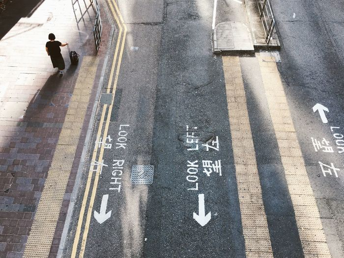 Street Real People One Person City One Man Only Waiting Choice Road Road Marking Pedestrian Left Or Right Journey Travel Travelling Urban