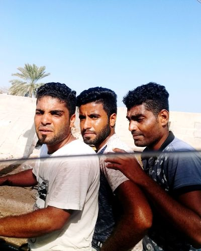 three friends in hormuz island near qeshm island in persian golf People People Photography Lifestyles Life Young Adult Motorbike Motorcycle Beach Life Hormuz Island Friendship Teamwork Men Togetherness Businessman Sky Sandy Beach Head And Shoulders Personal Perspective Friend The Portraitist - 2018 EyeEm Awards
