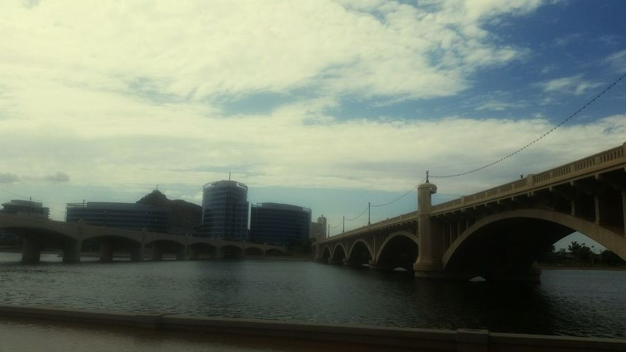 Tempe Town Lake Bridge - Man Made Structure Architecture Connection Reflection City Travel Destinations Built Structure Travel River Sky Water Outdoors Building Exterior Day Cloud - Sky No People Arch Cityscape Nature