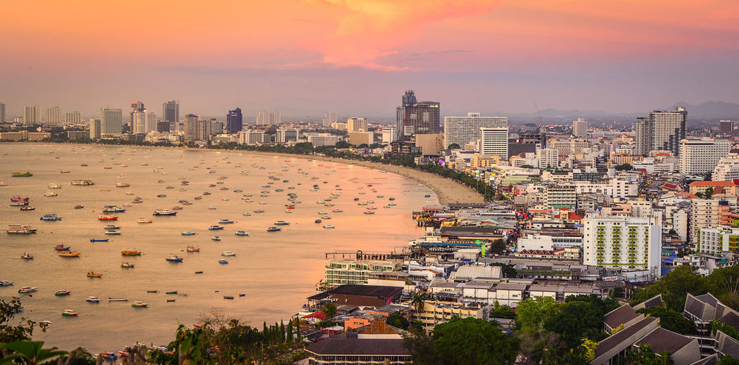 pattaya beach thailand Building Exterior Architecture Built Structure Sunset City Building Cityscape Orange Color High Angle View Residential District Water Cloud - Sky Transportation No People Office Building Exterior Nature Sky Skyscraper