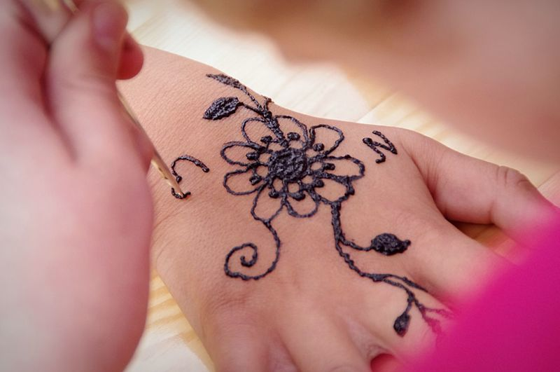 Doing a henna tattoo Henna Tattoo EyeEm Selects Human Body Part Human Hand Body Part Art And Craft Hand One Person Tattoo Close-up Creativity Women Adult Real People Human Skin Young Adult Design Skin