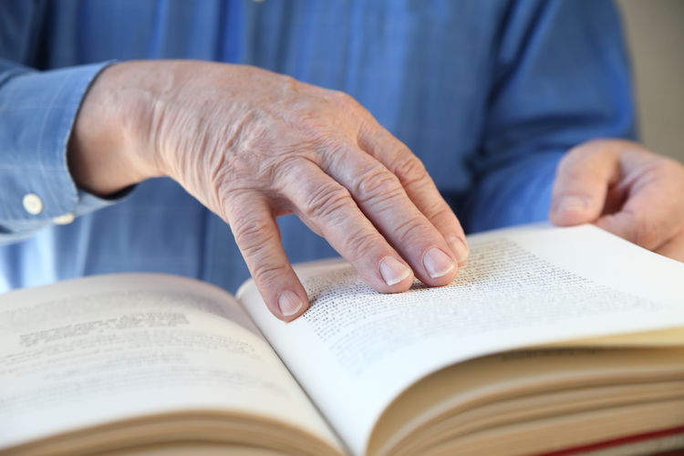 A senior man's hands on a book Book Business Shirt Fingers Hands Indoors  Learning Literacy Literature Man Natural Light Older Person Pages Of A Book Paper Perusing Reading A Book Research Senior Study Unrecognizable Person
